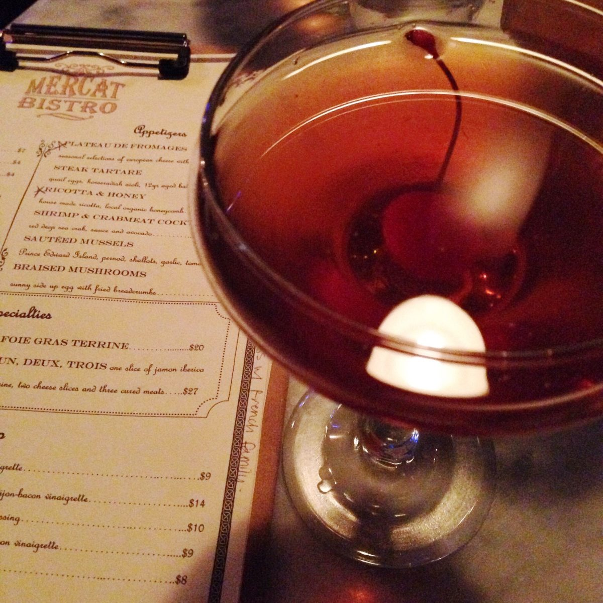 Manhattan cocktail (Texas whiskey, vermouth, bitters)